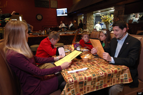 Republican vice presidential candidate, Rep. Paul Ryan, R-Wis., his wife Janna, and children Charlie, sitting next to Janna, Sam, and Liza look over the menu before ordering breakfast at Josie's restaurant, Friday, Oct. 12, 2012, in Lexington, Ky. (AP Photo/Mary Altaffer)