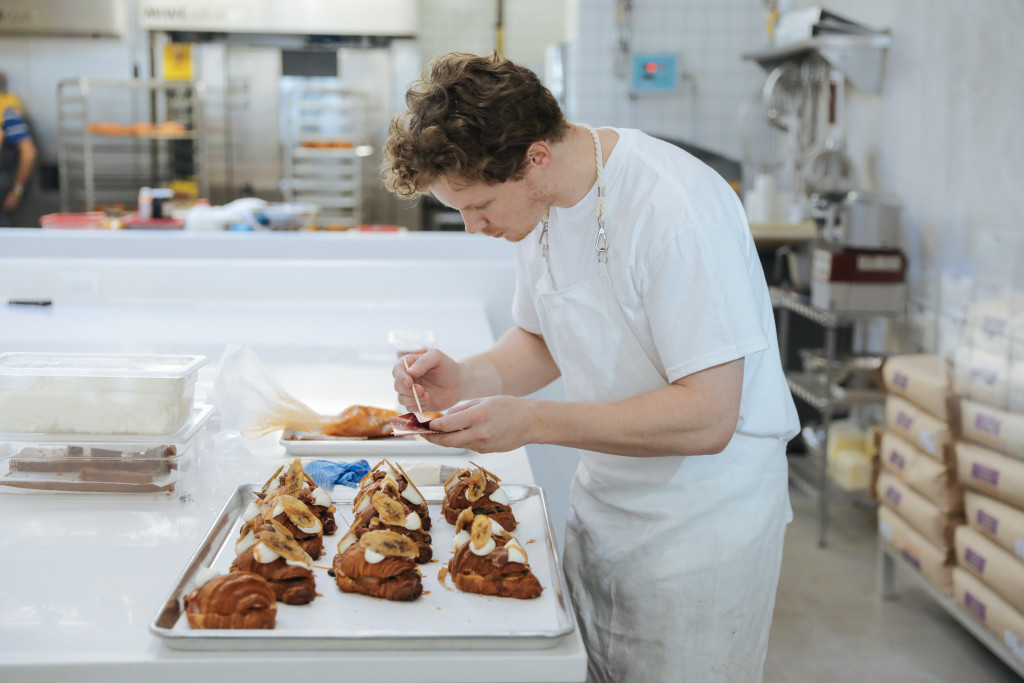 Co-founder Ry Stephen puts finishing touches on Lychee-Berry Jelly Bi-Color Croissants at Supermoon Bakehouse on Rivington St. in Manhattan.